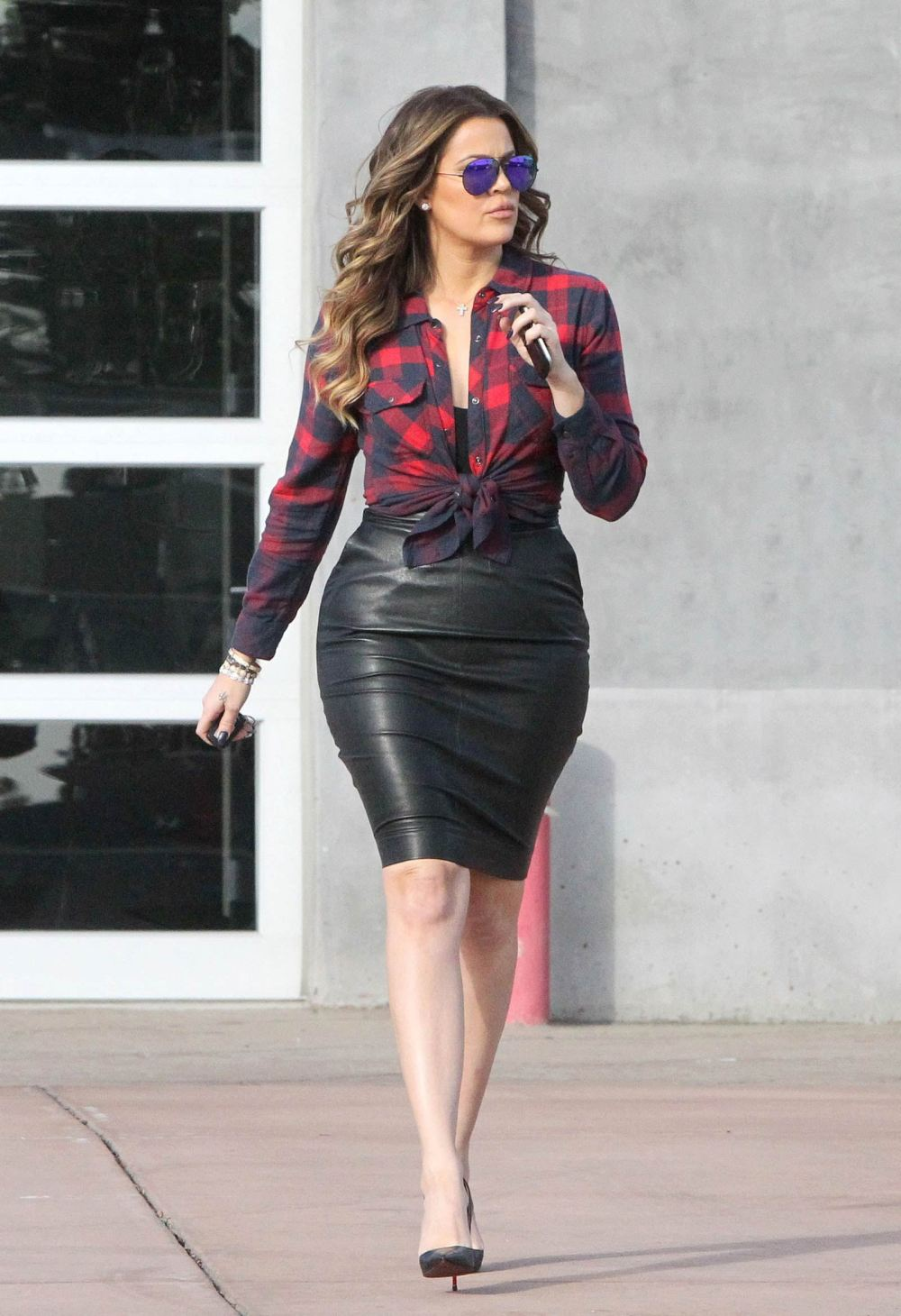 khloe in tight black leather skirt while