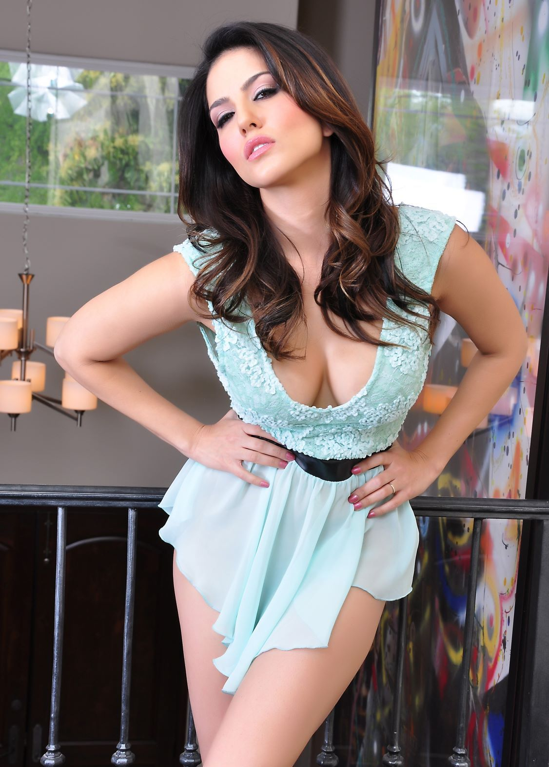 Hot Indian Model Sunny Leone for posing in Baby Blue Short ...